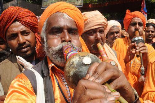 مارگیران در جریان تظاهرات علیه فقر در شهر دهلی نو هند