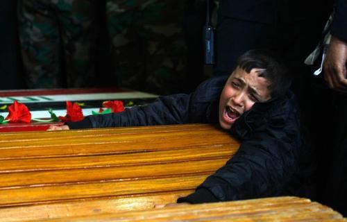 تابوت یکی از کشته شدگان عراقی در  جنگ سوریه