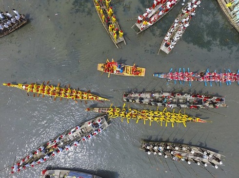 رقابت 300 قایقران در مسابقات قایقرانی مائوشو در جیانگسو چین