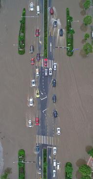 تصویری هوایی از سیل در شهر ژیاکسینگ در شرق چین
