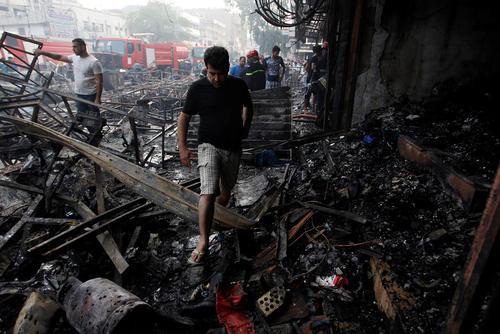 ویرانه های برجای مانده از انفجار تروریستی بامداد یکشنبه در بغداد